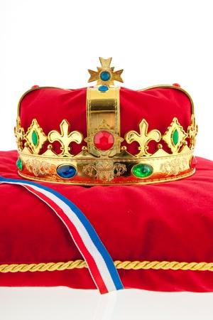 Golden crown on red velvet pillow for coronation in Holland Stock Photo - 18501965