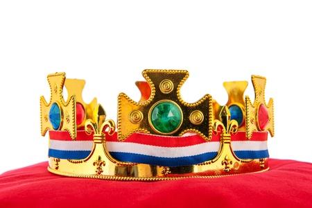Golden crown on red velvet pillow for coronation in Holland Stock Photo - 18501952