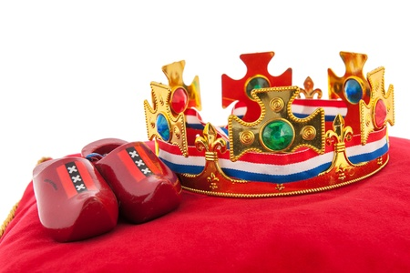 Golden crown on red velvet pillow for coronation in Holland Stock Photo - 18501968
