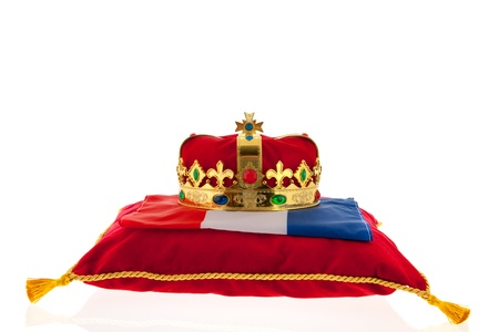 Golden crown on red velvet pillow for coronation in Holland Stock Photo - 18501887