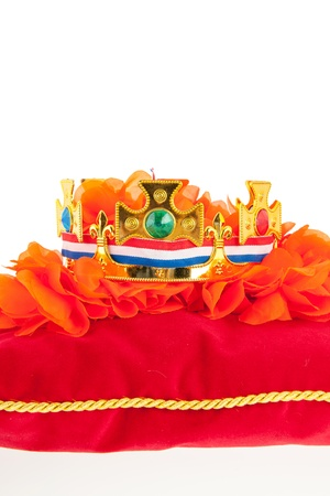 Golden crown on red velvet pillow for coronation in Holland Stock Photo - 18501960