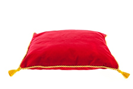 royal red velvet pillow with golden rope isolated over white background