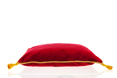 royal red velvet pillow with golden rope isolated over white background Stock Photo - 18501893