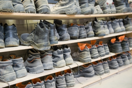 safety shoes: Racks with many safety shoes