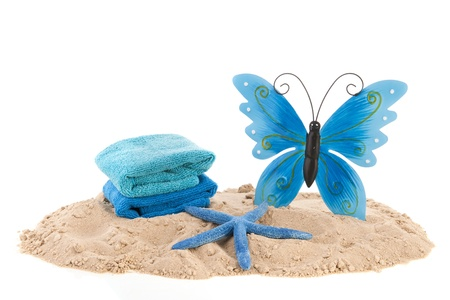 beach butterfly: Sand at the beach with towels and butterfly
