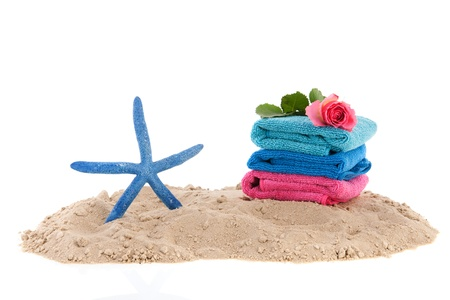 Sand at the beach with towels and starfish photo