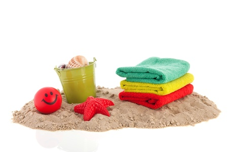 Sand at the beach with towels and toys photo