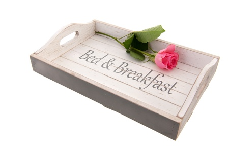 Wooden tray for bed and breakfast with pink rose photo