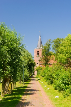 Dutch village with path to the church photo