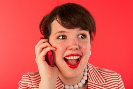 Young woman is having good news at the smartphone Stock Photo - 18766772