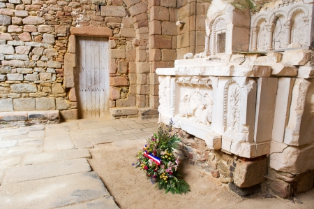 desecrated: Destroyed church with flowers in Oradour sur Glane in the French Limousin