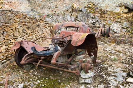 desecrated: leaved car in Destroyed Oradour sur Glane in the French Limousin