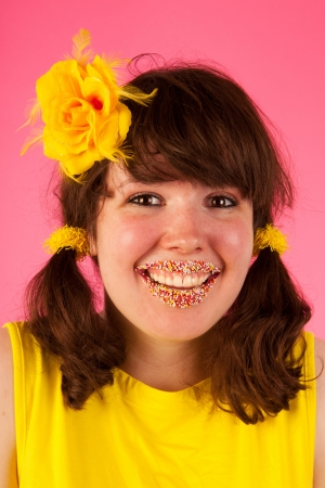 Sweet girl inyellow and pink with candy lips photo