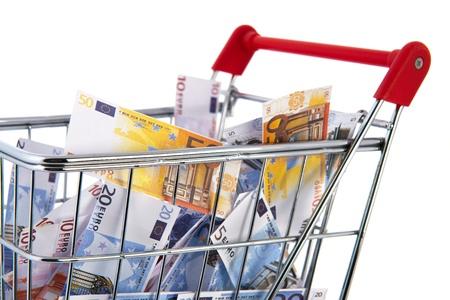 Shopping cart Euro banknotes isolated over white background photo