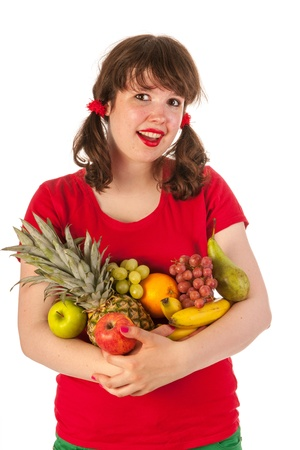 Happy young girl is loving fresh fruit photo