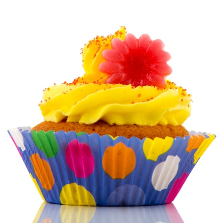 colorful cupcake with flowers and yellow butter cream photo