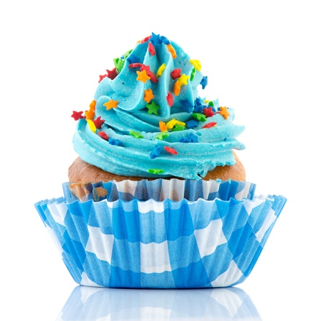 Blue birthday cupcake with confetti isolated over white background photo