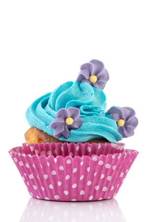 Blue birthday cupcake with flowers isolated over white background photo