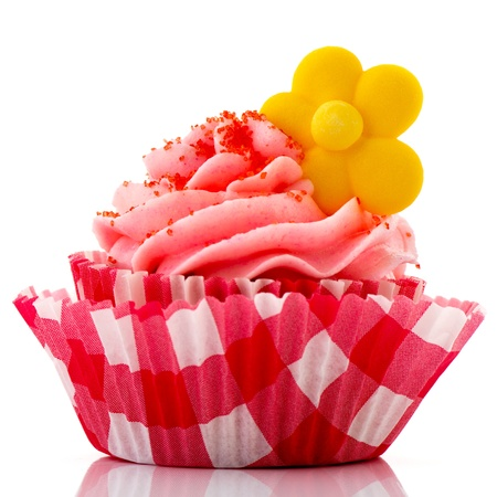Red cupcake with yellow flower and buttercream photo