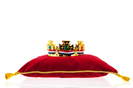 Golden crown on red velvet pillow for coronation in Holland Stock Photo - 19070926