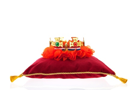 Golden crown on red velvet pillow for coronation in Holland Stock Photo - 19070922