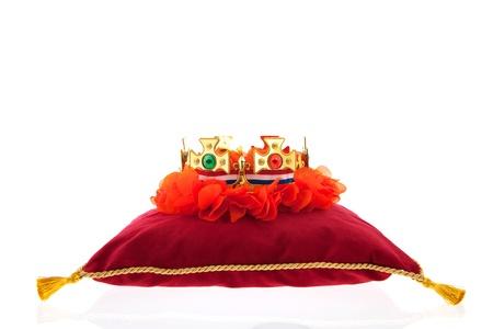 Golden crown on red velvet pillow for coronation in Holland Stock Photo - 19070922