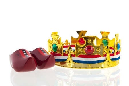 Dutch golden crown with flag colors for the king isolated over white background photo