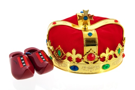 Dutch golden crown with wooden clogs from amsterdam isolated over white background photo