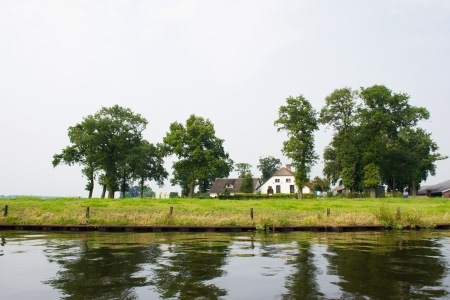 eem: Typical Dutch farmhouse near the river Stock Photo