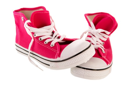pink basketball shoes isolated over white background photo