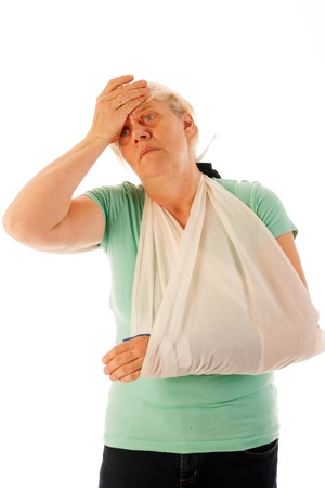 broken wrist: Old woman with broken wrist in blue gypsum isolated over white background