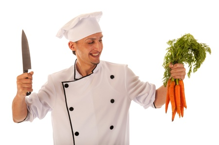 Cook preparing fresh carrots isolated over white background photo