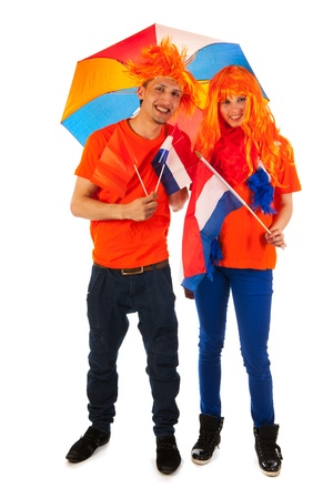 Young couple celebrating kings day in Holland photo