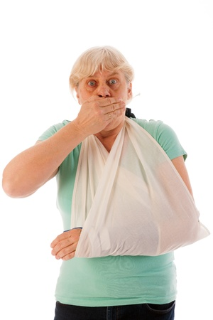 Old woman with broken wrist in blue gypsum isolated over white background Stock Photo - 19424895