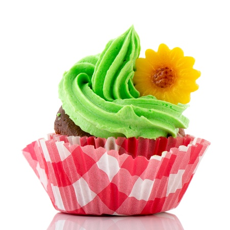 colorful cupcake in green and red with yellow flower photo