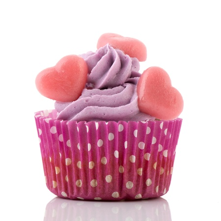 purple cupcake with butter cream and hearts photo