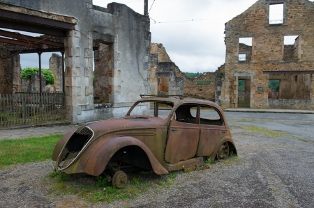 limousin: Destroyed car of doctor in Oradour sur Glane in the French Limousin Stock Photo