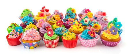 many sweet birthday cupcakes with flowers and butter cream photo