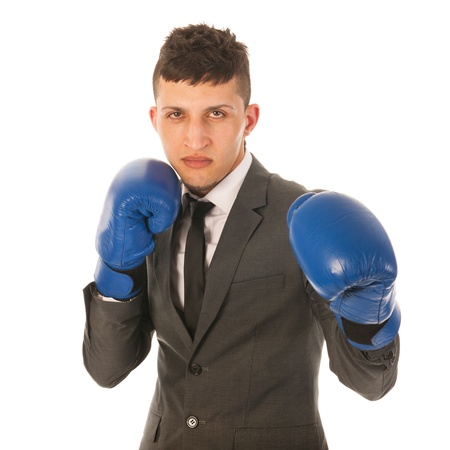 aggresive: aggressive businessman with boxing gloves Stock Photo
