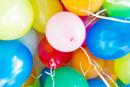 Many colorful balloons with ribbons photo