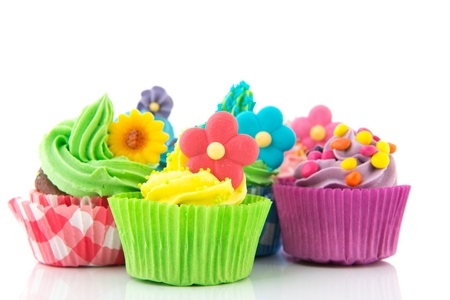 Colorful cupcakes with butter cream and flowers photo