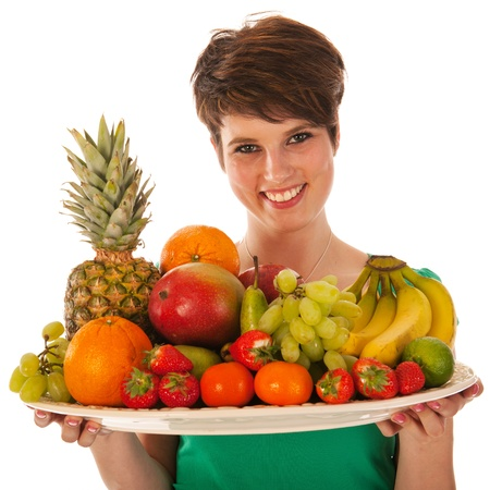 Pretty woman with assortment fresh fruit isolated over white background photo