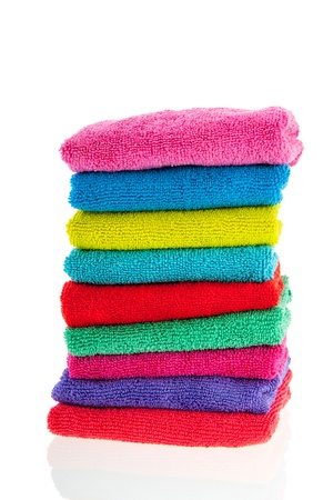 High pile with colorful stacked towels isolated over white background photo