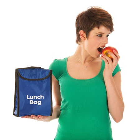 Woman with lunch bag is eating an apple photo