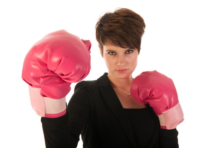 Young woman is enjoying a boxing fight in business isolated over white background photo
