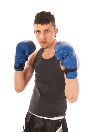 Boxing man with blue gloves isolated over white background photo