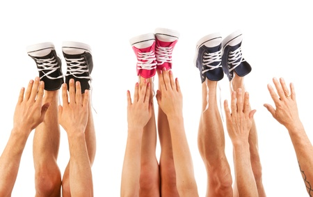 Feet in basketball shoes isolated over white background photo