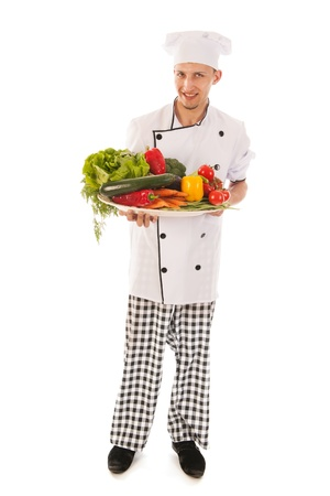 Cook with big assortment fresh vegetables isolated over white background photo