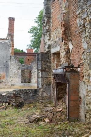 atrocity: Broken house in destroyed Oradour sur Glane in the French Limousin