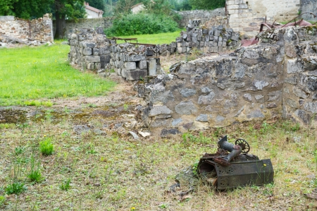 desecrated: Destroyed Oradour sur Glane in the French Limousin with rusty sewing machine